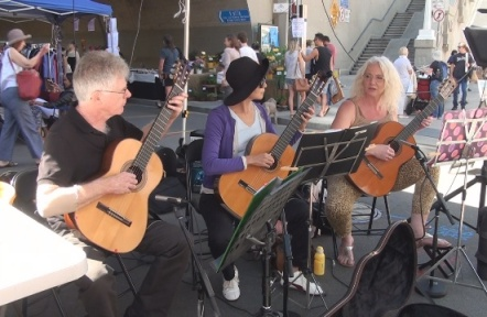 Guitar Trio playing at markets